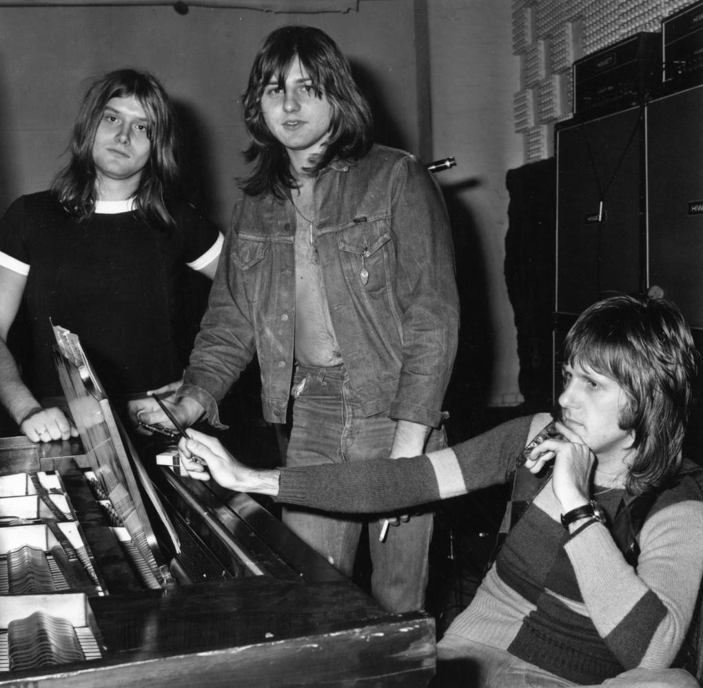 18th November 1971:  Progressive rock group ELP, or Emerson, Lake and Palmer, in the studio for the recording of their album, 'Trilogy'. From left to right: Carl Palmer (drums), Greg Lake (vocals, bass, guitar) and Keith Emerson (keyboards).  (Photo by Norman Quicke/Express/Getty Images)